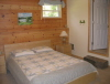 Buck Lake Cottage Rental #3-19~ Downstairs bedroom with queen bed and 3pc bathroom