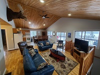 /Buck Lake Cottage Rental 31~Living and Kitchen/Dining Area