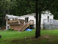 three mile lake cottage rental 22~Yard and Cottage Exterior