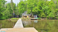 three mile lake cottage rental ~Yard and Cottage Exterior
